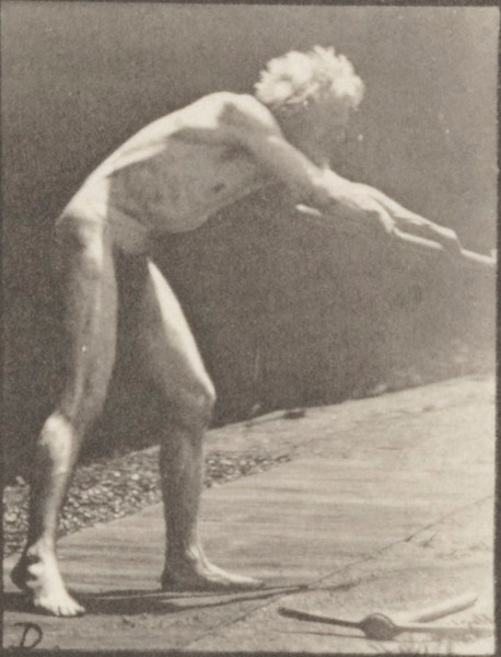 Nude man using a shovel