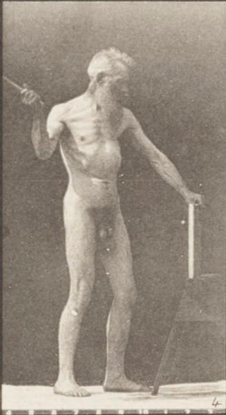 Nude man using a hatchet