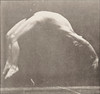 Nude man doing a handspring