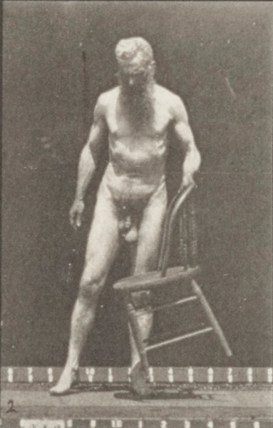 Nude man sitting down