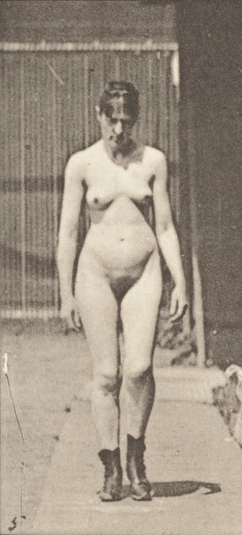 Nude woman walking in high-heeled boots