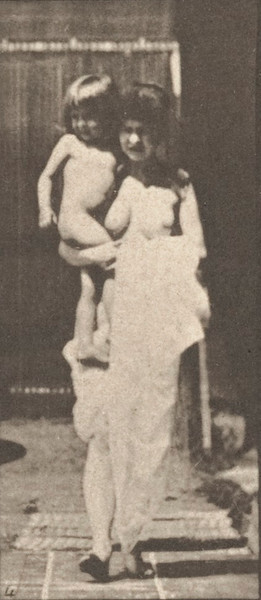 Female semi-nude walking and carrying child on right arm