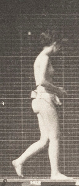 Nude woman walking with both elbows bent