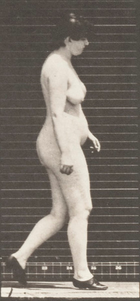 Nude woman walking with shoes on