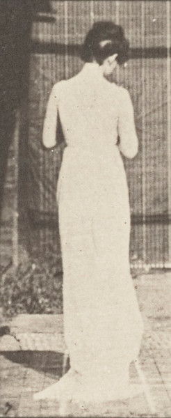 Semi-nude woman walking with her hands engaged in knotting