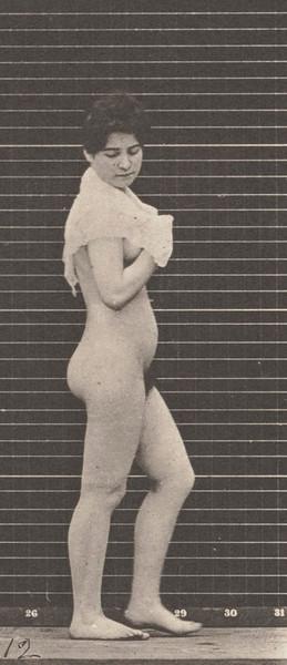 Nude woman walking and throwing handkerchief over shoulders