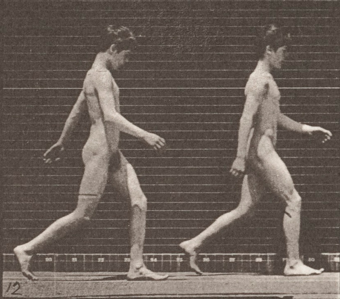 Two nude boys walking