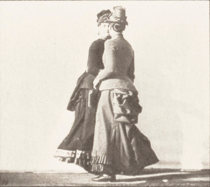 Two women walking, meeting and partly turning