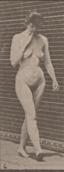 Nude woman walking keeping her right hand at her chin