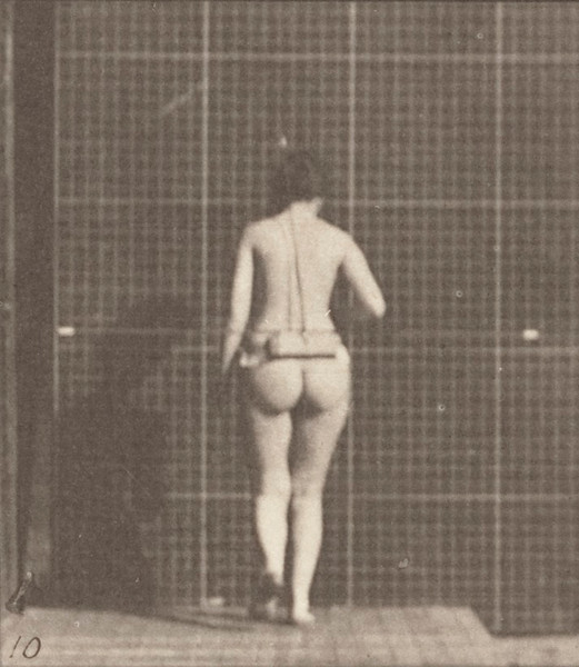 Nude woman walking with right elbow bent