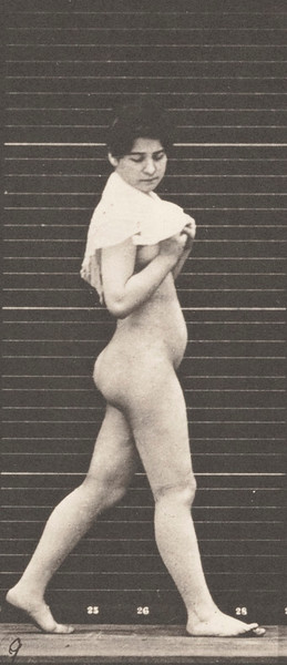 Nude woman walking and throwing handkerchief over shoulders