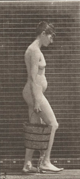 Nude woman walking with a bucket of water in each hand