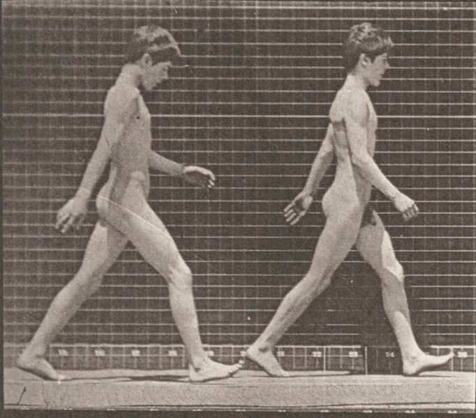 Two nude boys walking