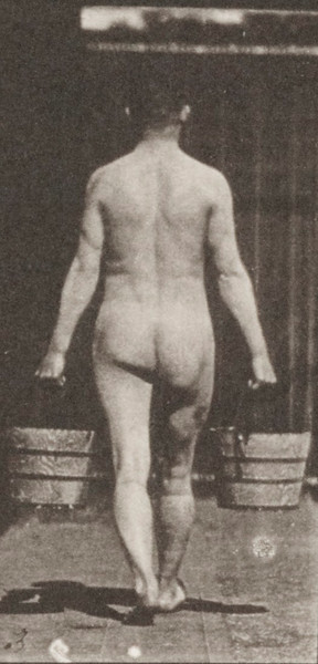 Nude man walking with a bucket of water in each hand