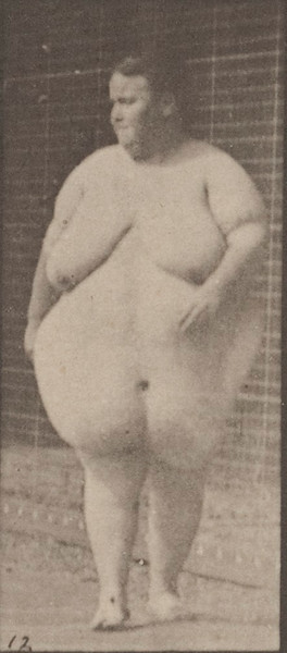 Overweight nude female walking and commencing to turn around