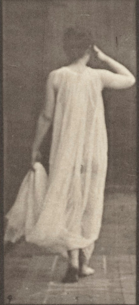 Female semi-nude walking with hand holding dress and hand at face