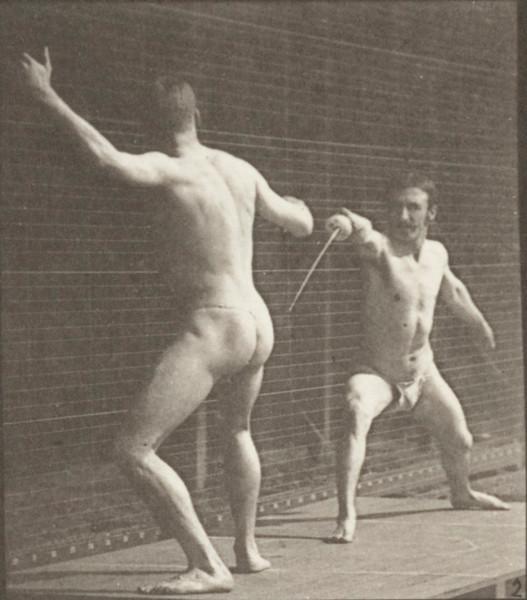 Two men in pelvis clothes fencing