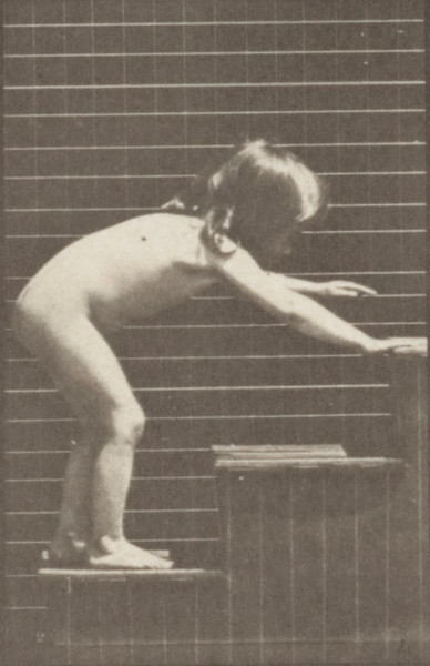 Nude child crawling on stairs
