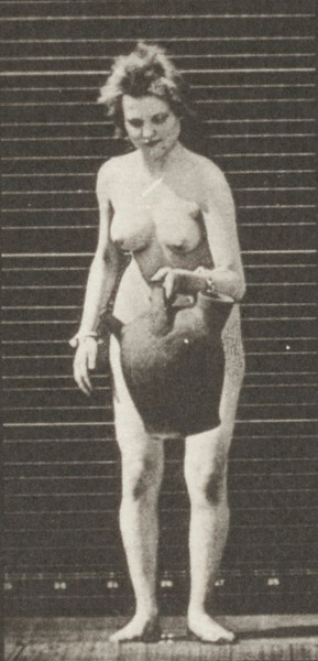 Nude woman removing a water jar from shoulder to the ground and turning