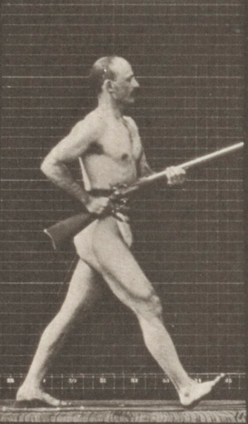 Man in pelvis cloth charging with bayonet