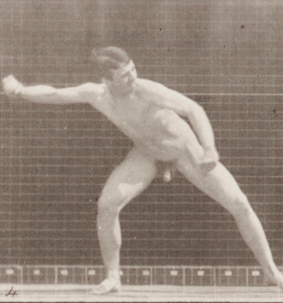 Nude man playing baseball, pitching