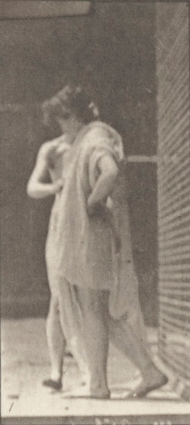 Nude woman disrobing another