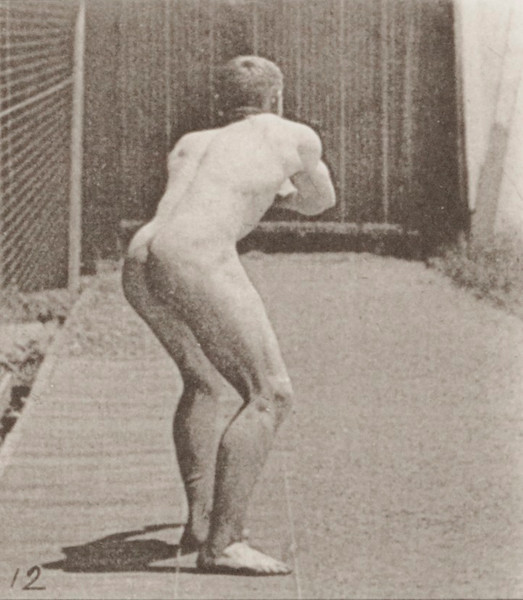 Nude man catching baseball