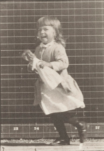 Child lifting doll and walking