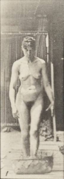 Nude woman stooping and  lifting a 12-lb. basket to head