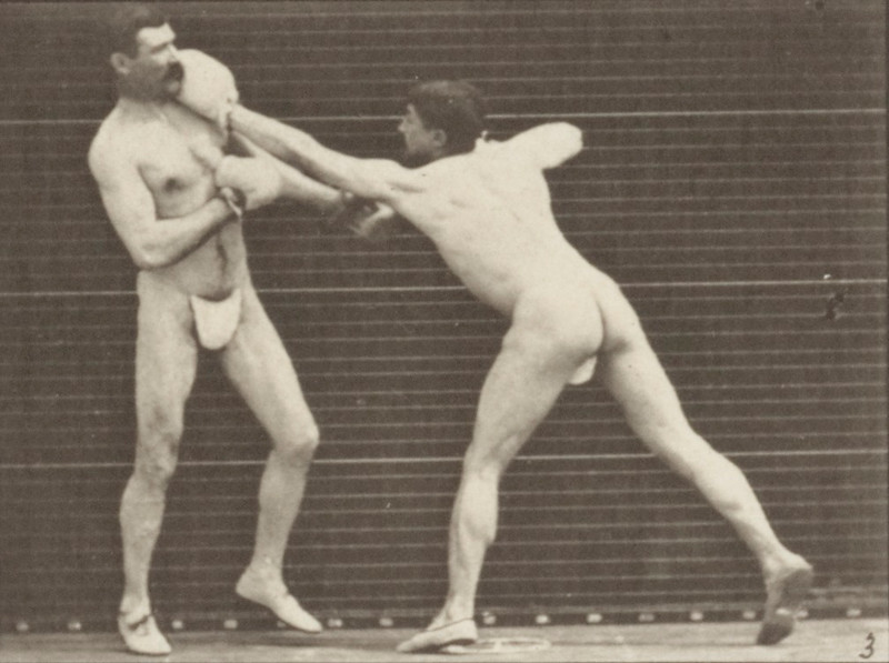 Two men in thong underwear boxing with gloves