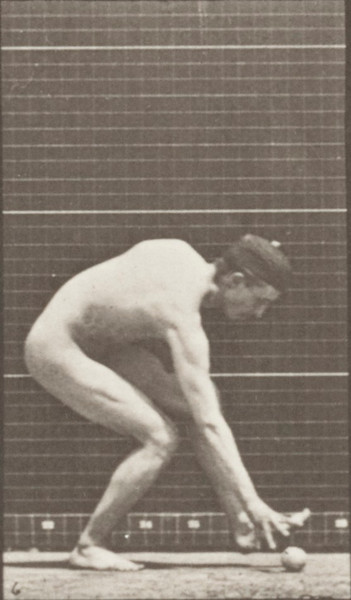 Nude man running and picking up the ball