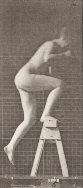 Nude woman stepping on and over a trestle
