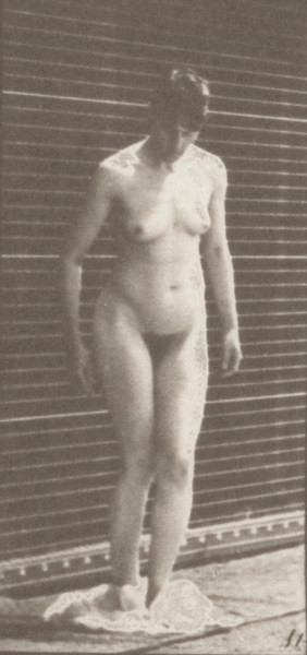 Nude woman taking off clothing