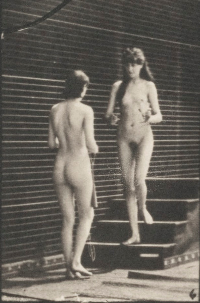 Nude woman descending stairs with a golblet meets another woman with a bouquet