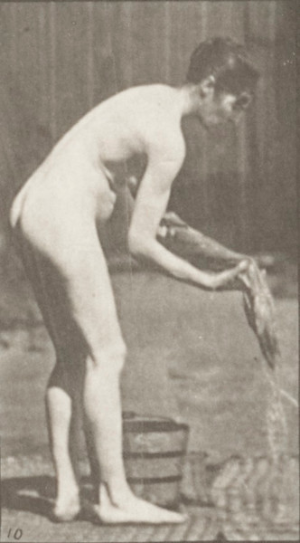 Nude woman wringing clothes