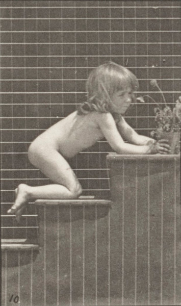 Nude child walking on stairs
