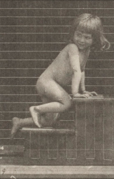 Nude child crawling