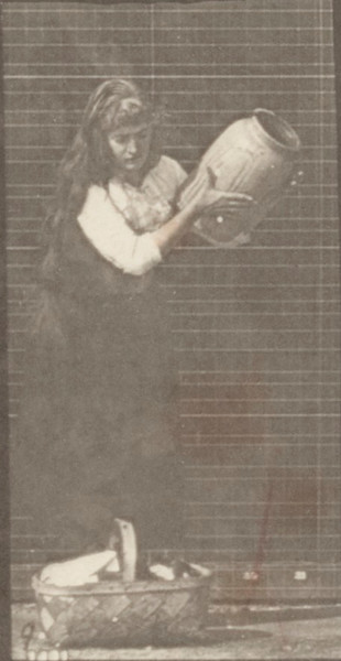 Draped woman carrying a jar on her shoulder and a basket in her hand then placing them on the ground