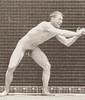 Nude man catching baseball