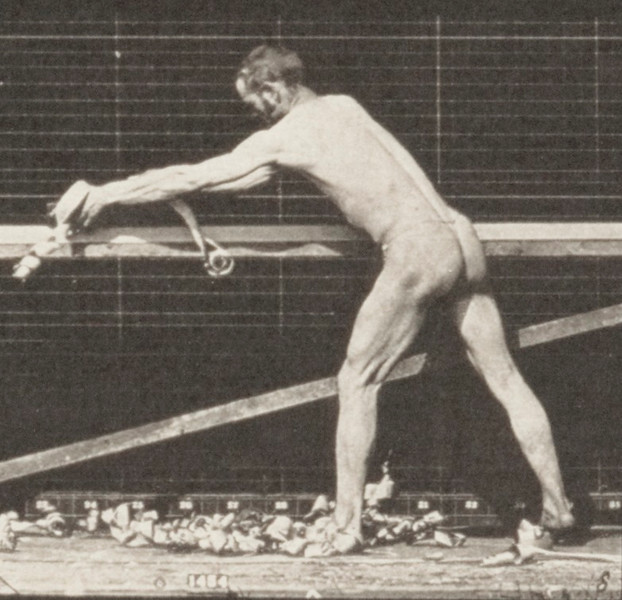 Man in pelvis cloth planing a board