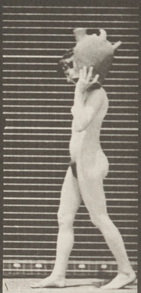 Nude woman removing a water jar from shoulder to the ground
