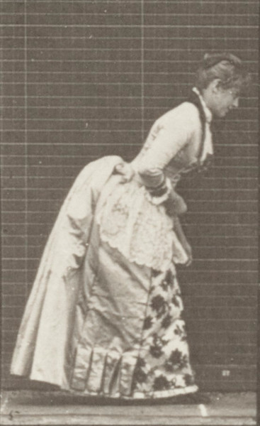 Woman in historical costume curtseying