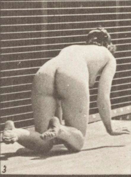Nude woman crawling