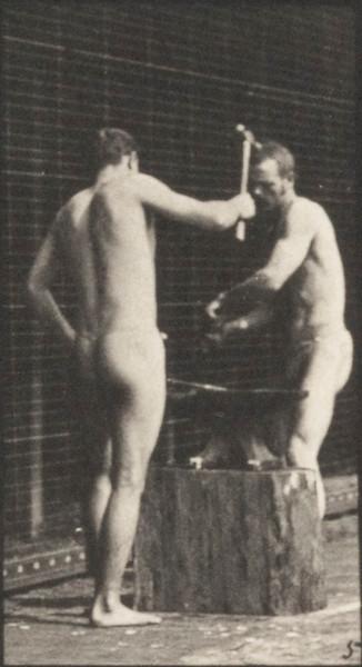Men in pelvis clothes hammering an anvil