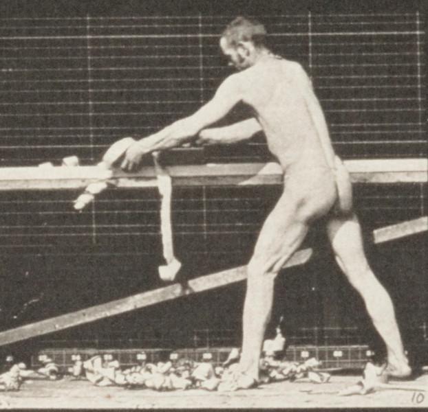 Man in pelvis cloth planing a board