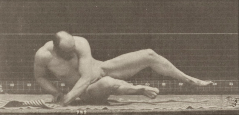 Nude man arising from the ground and walking off