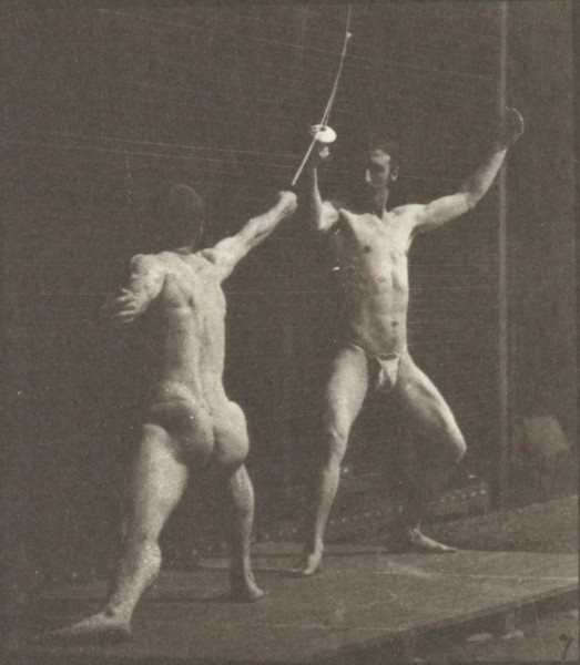 Two men in pelvis clothes fencing