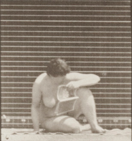 Nude woman arising from the ground with a pamphlet in left hand