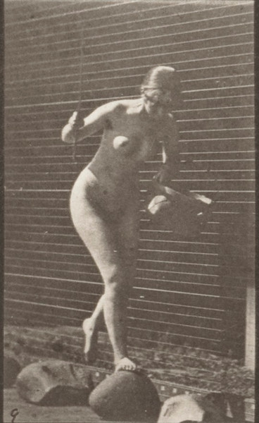 Nude woman crossing brook on stepping-stones