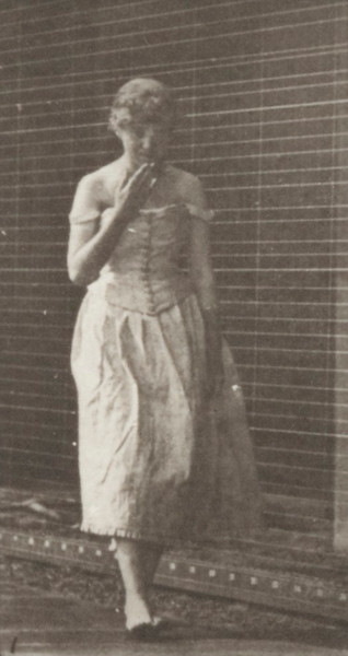 Woman in long dress curtseying, kissing hand and turning around